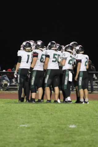 Warsaw Football team gathering during a time out. Warsaw lost to butler in the district football game 6-40.