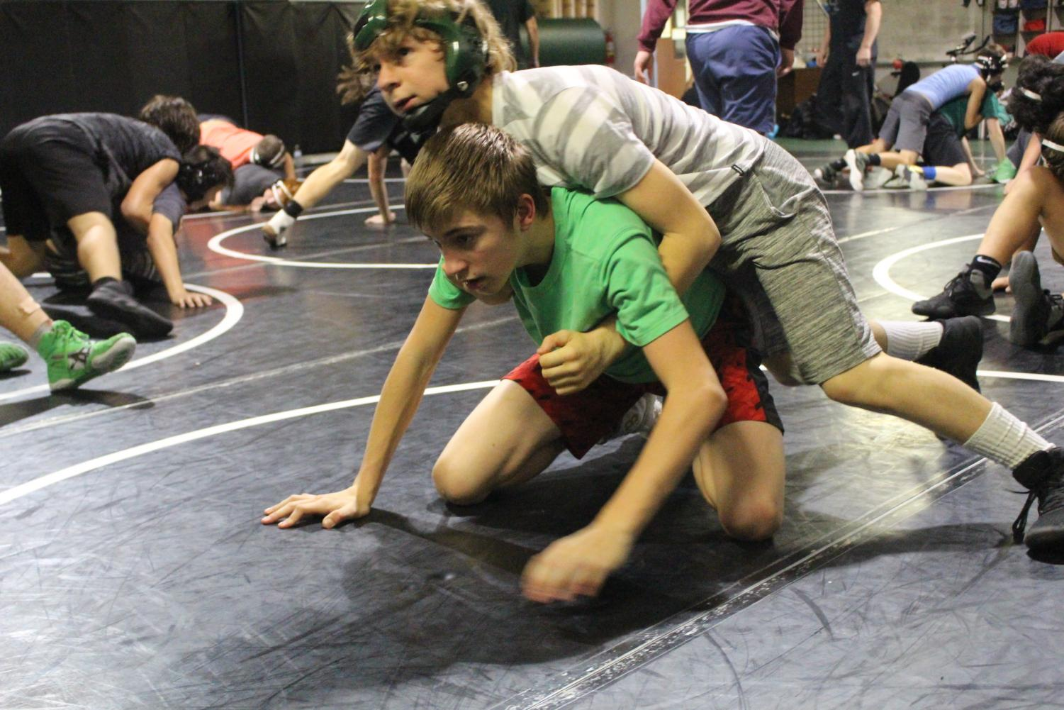 Freshmen Benton Breshears and Brenden LaBoube wrestle with one another during practice. Breshears wrestled during middle school.