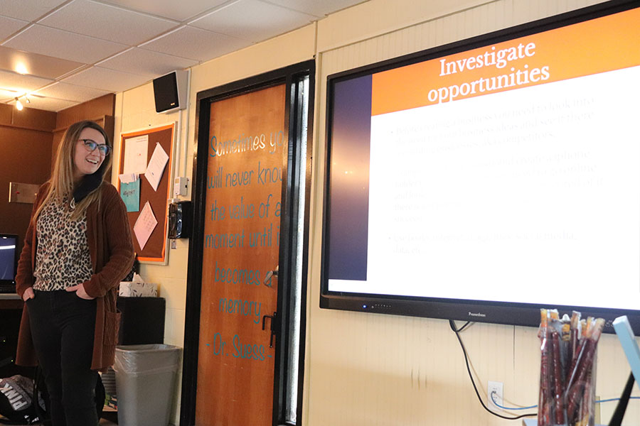 Student teacher Emily Banfield does a presentation in one of Bethany Siegel's classes. Banfield has been student teaching in the WHS business department all semester.