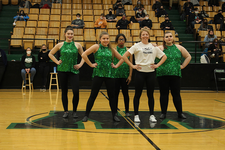 Dance team members senior Lauren Kreisel, sophomore Lilia Jensen, freshman Breanna Burriss, junior Kaylee Lawson and senior Sabrina Uptgraft perform their jazz routine during the Courtwarming assembly on March 11. The dance team placed first overall at their very first competition, the State Fair Spirit Classic National Cheer and Dance Competition, on March 20.