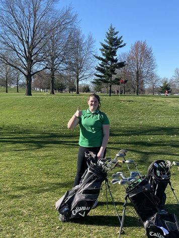 Sophomore Ashley Spry poses for picture at Tipton Golf Match.