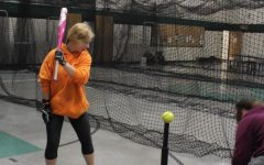 Sophomore Isabelle Edge prepares to swing at the ball during  after school softball practice. the team was hard to work in preparation for there first game on March 27.