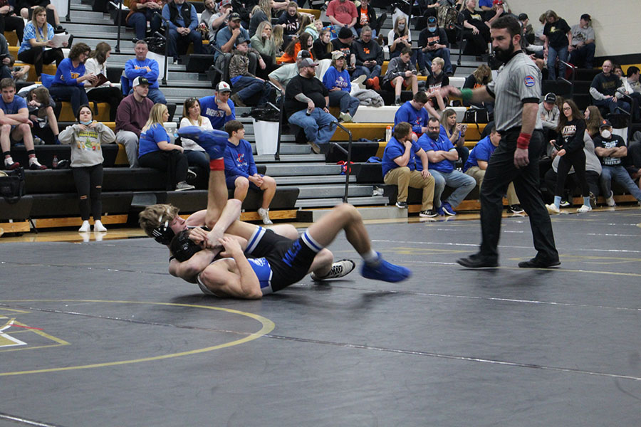 Sophomore Nick Bagley (132 weight class) wrestles his opponent during the sectional tournament on Feb. 27. Bagley placed second to advance to the state wrestling tournament.