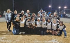 The team celebrates their district win over Adrian. This was the fourth consecutive district title for the Wildcats.