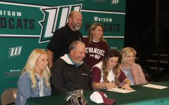 Pitcher Kylee Fajen accepted a scholarship to play softball at Evangel this fall. She celebrated her signing with (front row) coach Kelli Eierman, coach Steve Larson, coach Megan Daleske; (back row) her parents David and Brandy Fajen.