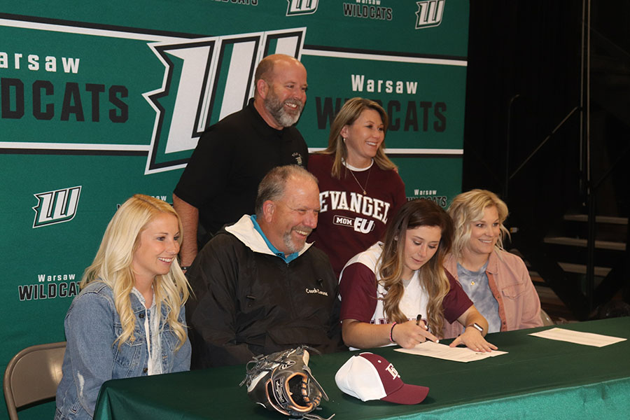 Pitcher+Kylee+Fajen+accepted+a+scholarship+to+play+softball+at+Evangel+this+fall.+She+celebrated+her+signing+with+%28front+row%29+coach+Kelli+Eierman%2C+coach+Steve+Larson%2C+coach+Megan+Daleske%3B+%28back+row%29+her+parents+David+and+Brandy+Fajen.