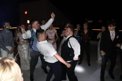Senior Grant Miller and guest Aidan Lemmons dance on the rooftop of The Lodge of Four Seasons. One of the dance highlights was Miller doing the worm.