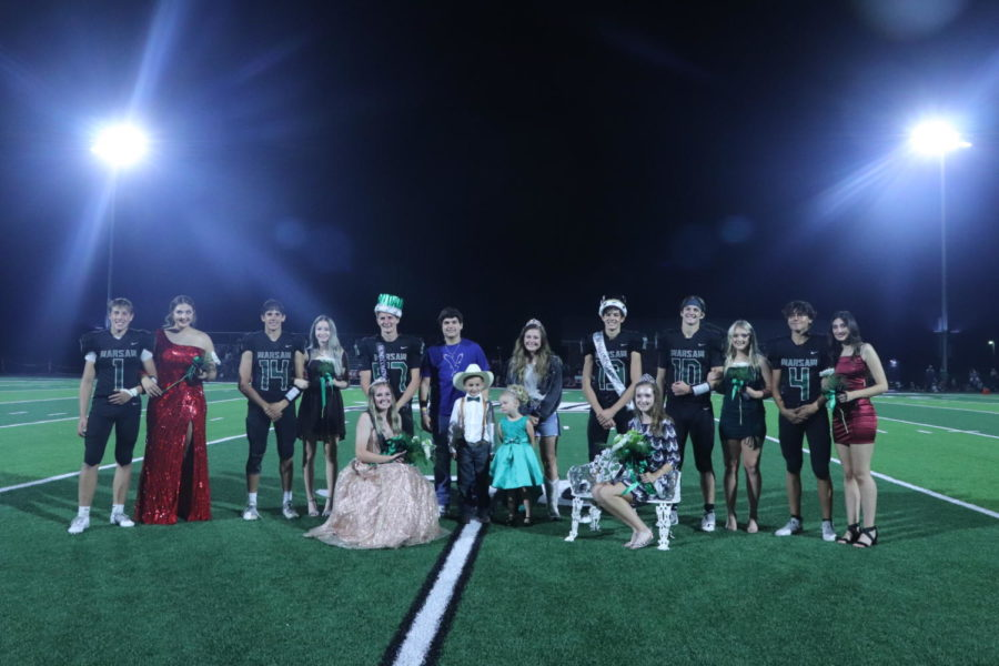 The+Homecoming+court+celebrates+at+coronation.+They+include%3A+juniors+Gage+Whitaker%2CEliie+Murrell%2C+Tayten+Boyer%2C+Faith+Tharaldson%2C+prince+Hudson+Karr%2C+princess+Jazzmyn+Swisher%2C+2020+king+Austin+Brazel%2C+2020+queen+Kylee+Fajen%2Ccrown+bearers+Maddox+Brewster+and+Haven+Hinkle%2C+seniors+king+Grant+Chapman%2C+queen+Alyssa+Alcantara%2C+Brady+Slavens%2C+Taylor+Howe%2C+Giovannni+Pagliani+and+Taylar+Kleihauer.+%0A