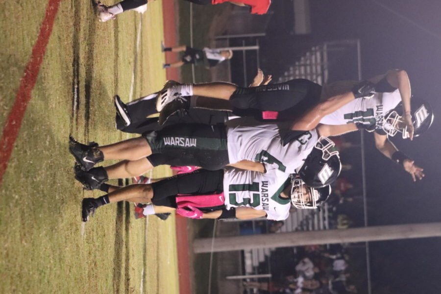 Senior+left+tackle+and+defensive+end+Garrett+McGann+lifts+senior+quarterback+Brady+Slavens+to+celebrate+a+touchdown+against+the+El+Dorado+Springs+Bulldogs.+The+Wildats+beat+the+Bulldogs+50-20.