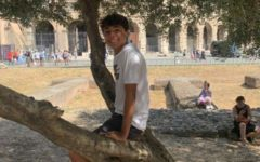 Senior Giovanni Pagliani sits in front of the Colosseum in Italy last year.