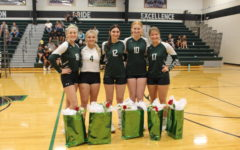 Volleyball seniors Emma Johnson, Taylor Howe, Taylar Kleihauer, Karlie Jones, and Bella Morrison come together for a picture before their senior night game against the Osecola Indians on Sept. 6. Volleyball seniors were recognized for all of their hard work before the varsity game.