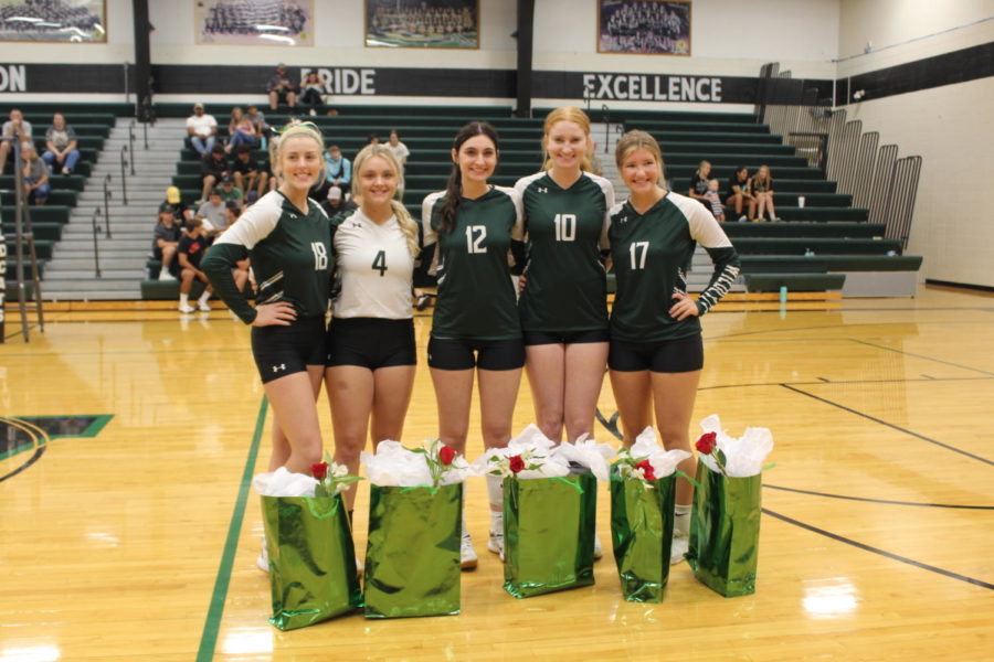 Volleyball+seniors+Emma+Johnson%2C+Taylor+Howe%2C+Taylar+Kleihauer%2C+Karlie+Jones%2C+and+Bella+Morrison+come+together+for+a+picture+before+their+senior+night+game+against+the+Osecola+Indians+on+Sept.+6.+Volleyball+seniors+were+recognized+for+all+of+their+hard+work+before+the+varsity+game.