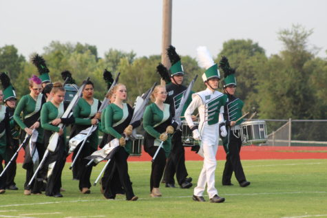 Drum major Logan Schockmann leads the band on to the field at El Dorado clinic.