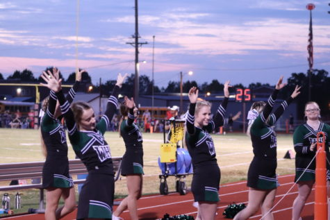 The Wildcat Cheerleaders cheer on the football team while playing against the El Dorado Bulldogs on Oct. 1.